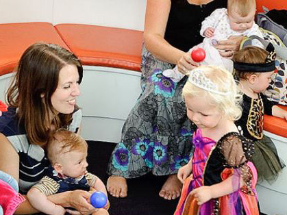 Babies and children in dressing up clothes with their mothers