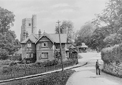 Historical black and white depicting a farmhouse near the church in Seal